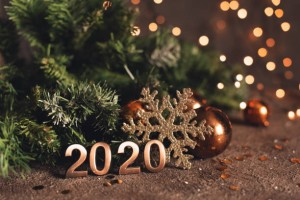 Happy New Year 2020. Symbol from number 2020 on wooden background.
